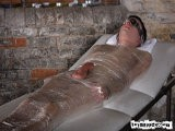 Blindfolded and Wrapped Tight In Cling Film Like a Modern-day Twink Mummy, Aaron Aurora Is In No Position to Protest an Older Man Playing With His Exposed Cock - the Only Thing Allowed Out of That Wrap. It Gets Rock Hard From the Attention and Stroked, With Aaron None the Wiser to His Captor.<br />