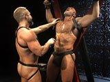 gay porn Loud And Nasty Scene 3 || Testosterone-fueled Dirk Caber ties big stud Jesse Jackman to a St. Andrew's Cross, then breaks out a violet wand. He runs it along the tender skin of Jesse's hard, hairy chest, inching its charged tip over his armpit and his nips as Jesse's eyes roll back in his head and he noisily growls. The two men swap spit, laughing in the moments between each shock. Dirk frees their rock-hard tools from their leather jocks, touching the heads together and pulling back, a string of precum connecting them. With other tools that turn him into a human conductor, Dirk strokes his bare hand against the massive slabs of Jesse's chest, his fingertips shooting jolts over Jesse's skin. Dirk unties Jesse from the cross, throws him back on a bench, lifts Jesse's muscular legs, then proceeds to feast on his hairy hole, getting it wet and ready for his thick meat, which he slides into Jesse's tight and hungry hole. Dirk flips him on his belly and pounds him mercilessly from behind, holding tight to Jesse's harness and laughing at the noises Jesse makes as Dirk plunges balls-deep into the muscle butt. But now Jesse revolts, aiming a stun gun at Dirk's leg and growling as Dirk falls to the floor. Jesse pisses all over Dirk's chest, cock, and balls, soaking him before pointing the stun gun at Dirk's wet flesh and shocking him in sweet revenge. Jesse throws Dirk on the bench and shoves his own thick meat into his former tormenter's twitching hole. Dirk gives into the pleasure of the big man's butt plowing, stroking his throbbing cock until his cum rains down on his black jock. This pushes Jesse over the edge, and he screams as he unloads all over Dirk's wet, still-hard cock.