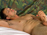 gay porn Petty Officer Chris || 'Petty Officer Chris has spent several years in the sweaty underbelly of a nuclear submarine, in the Navy. He talks about being on deployment and the grueling 12 hour days with little or not sleep. Guys on subs have, 2 bunks for 3 guys. Sometimes that makes it difficult to get your personal needs satisfied. Chris says you're never more than 4 feet from a circle jerk when the boat is submerged. Military men try to respect each others' privacy. So, Chris says he's never actually been in a circle jerk or engaged in sex on a ship. This lean muscular stud has piercing blue eyes and an oversized uncut dick. He lays back on the bed and starts working on his little sailor through his jeans. He takes off his shirt to reveal abs and pecs developed from years of military service. Speaking of military service, this guy can't wait to get his pants unbuttoned and get his cock at full salute. He strokes rhythmically while his balls bounce against his bulging taint. He gets up on all fours to give his pink pucker a little digital action, sliding his finger into the velvet hallway. Rolling onto his back, he begins to jack his meat more intensely. His abs tense and his legs stiffen and his cock begins to spit out the contents of his nuts. He moans as the thick Naval semen pools up in his navel. His hand is coated in thick gobs of whiteness. He finally relaxes, breathing heavily as he recovers from the military operation at hand.