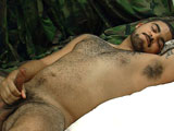 gay porn Private Alex || Private Alex has spent some time fighting the bad guys for his country as a United States Marine. He even took fire a couple times and protected his base from enemy attack. When this sexy bear of a Marine starts to rub on his cock, the swelling is evident right away. When he pulls his dark thick cock from his pants, it's already standing at full attention. Continuing to stroke, it is obvious in his dark brooding stare that he is very involved in his current mission. He takes off his shirts to reveal a muscled, tattooed, hairy chest and bulging biceps. He picks up the pace as his strokes become more rapid and rhythmic. Settling in for more self pleasure, he slides his camouflage pants down to his boots, uncovering thick hairy legs and nice pubic bush. He lays back on the bed and works on his love muscle, milking it harder and harder. He props up his head with his left hand and his bicep bulges, stretching the U.S.M.C. that is tattooed on the underside of it. His legs start to tense and his whole body becomes stiff. As he starts to cum, deep groans emanate from his chest. The cum squirts from the tip of his dick and lands on his chest and stomach.
