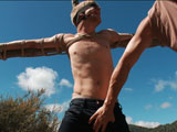gay porn Logan Stevens || Alone on a hike is Logan Stevens, enjoying the great outdoors while a horny perv lurks in the forest. After being taken, Logan finds himself tied to a cross on top of the mountain. The perv cuts his clothes off and Logan's huge cock gets hard. Edged and flogged under the hot sun Logan screams into the forest. The perv then dildo fucks Logan's ass and mouth after suspending him on one leg from a tree. Fully suspended Logan is continuously fucked and made to cum in mid air.